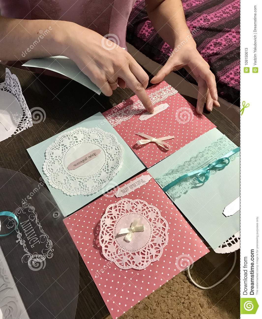 The girl is engaged in making greeting cards at home using paper royalty free stock photo download the girl is engaged in making greeting cards m4hsunfo