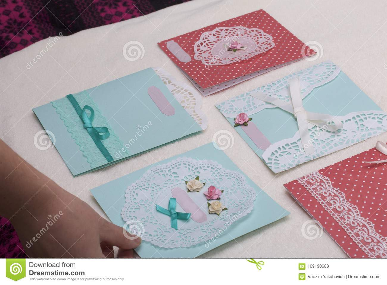 The girl is engaged in making greeting cards at home using paper the girl is engaged in making greeting cards at home using paper lace braid and other materials m4hsunfo