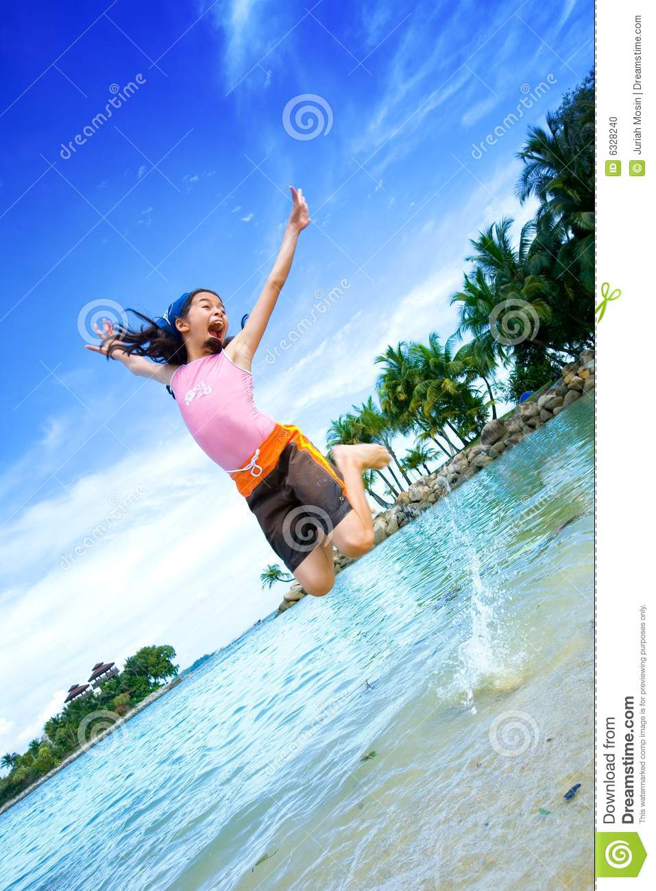 Girl excited, jumping on the lagoon beach