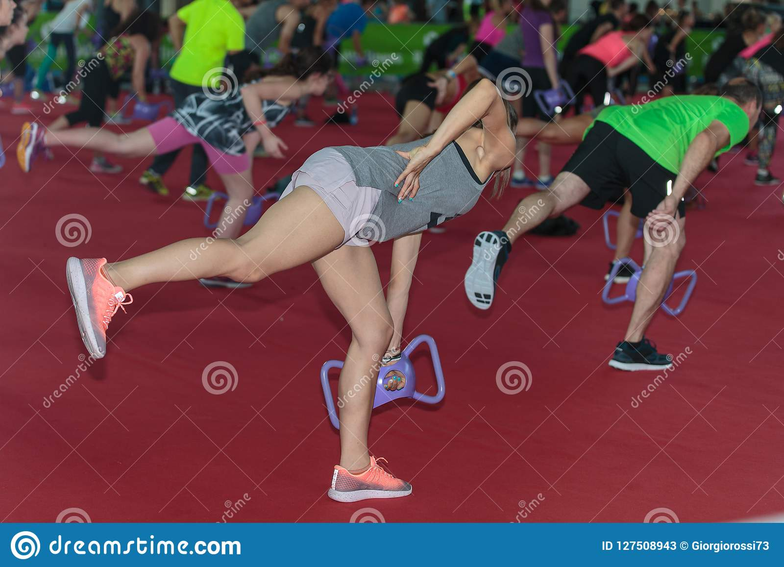 Girl Exercising With Gym Dumbbell In Fitness Class At Gym Editorial