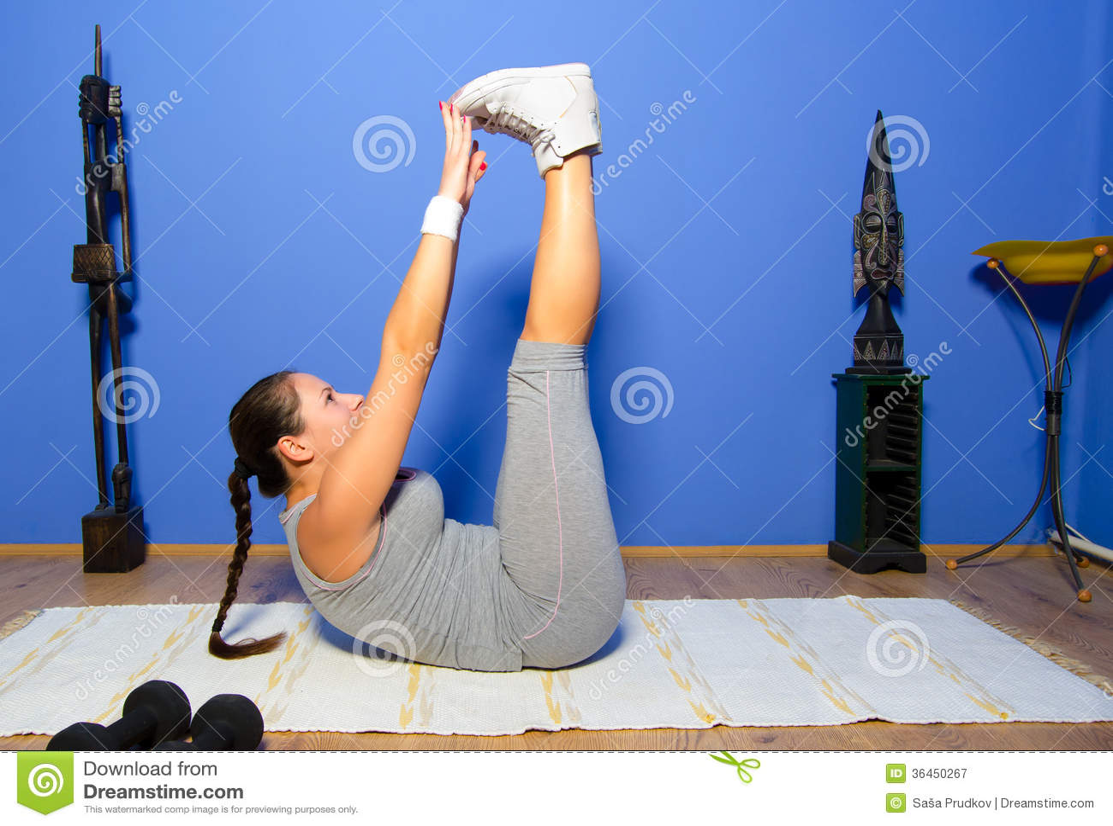 Girl exercising at home