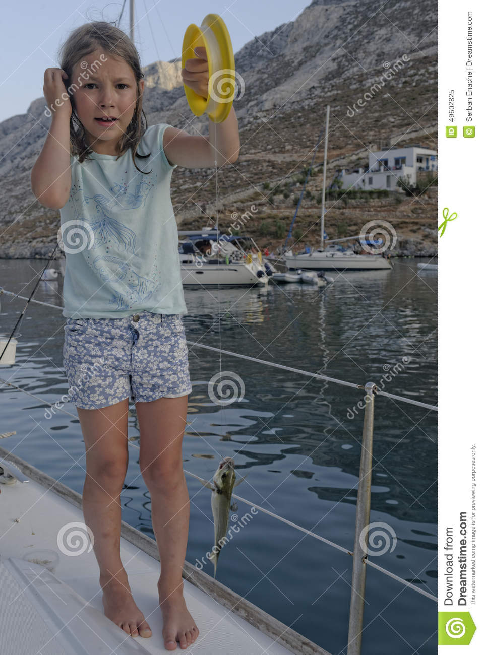 Girl Fishing From A Boat Stock Photo - Image: 49602825