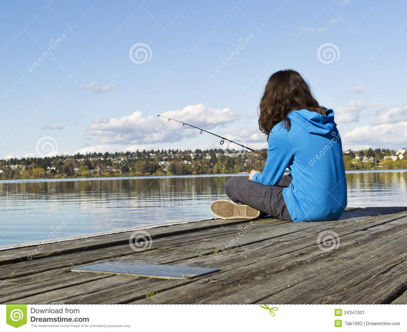 Girl fishing off dock stock image image 24347001 for Little girl fishing pole