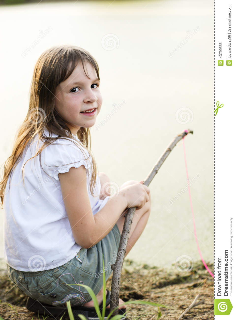 Girl fishing with a stick and line stock photo image of for Girl fishing pole