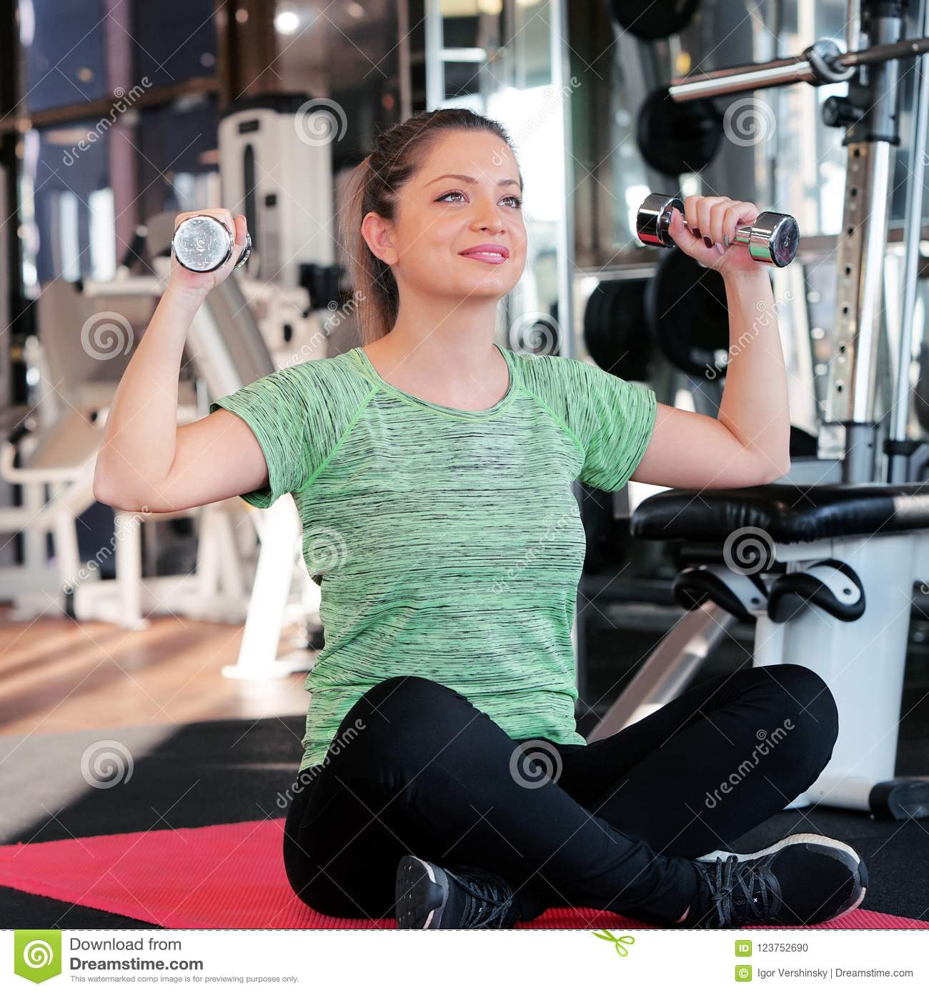 Girl On The Floor With Dumbbells Stock Photo - Image of