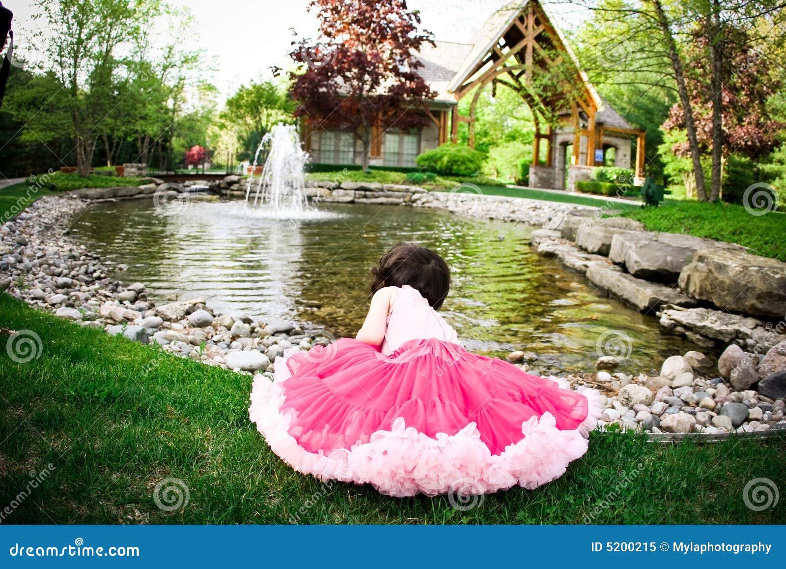Girl In Flower Garden Royalty Free Stock Photo