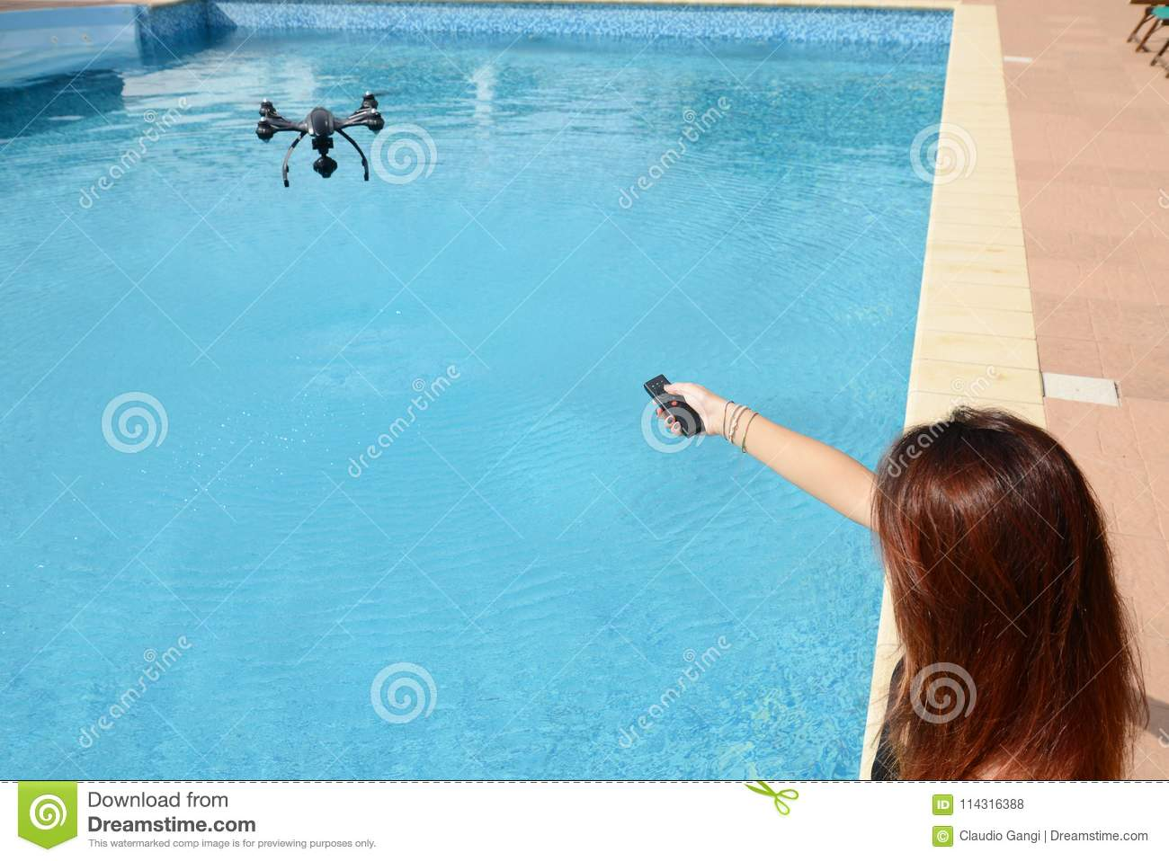Girl Fly Drone With Remote Control By The Swimming Pool Stock Photo ...