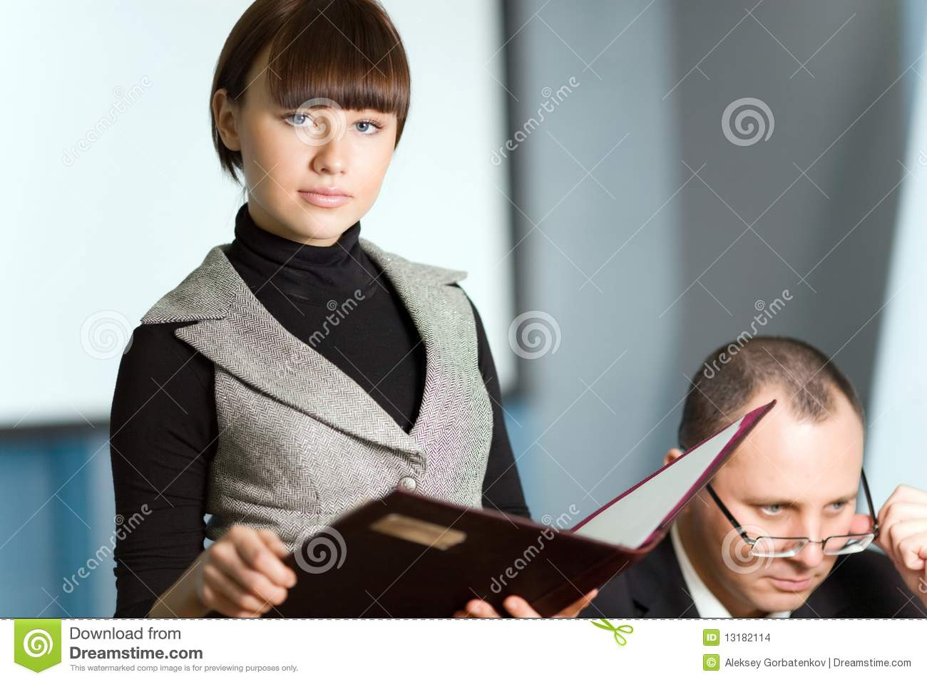 Girl with folder and men