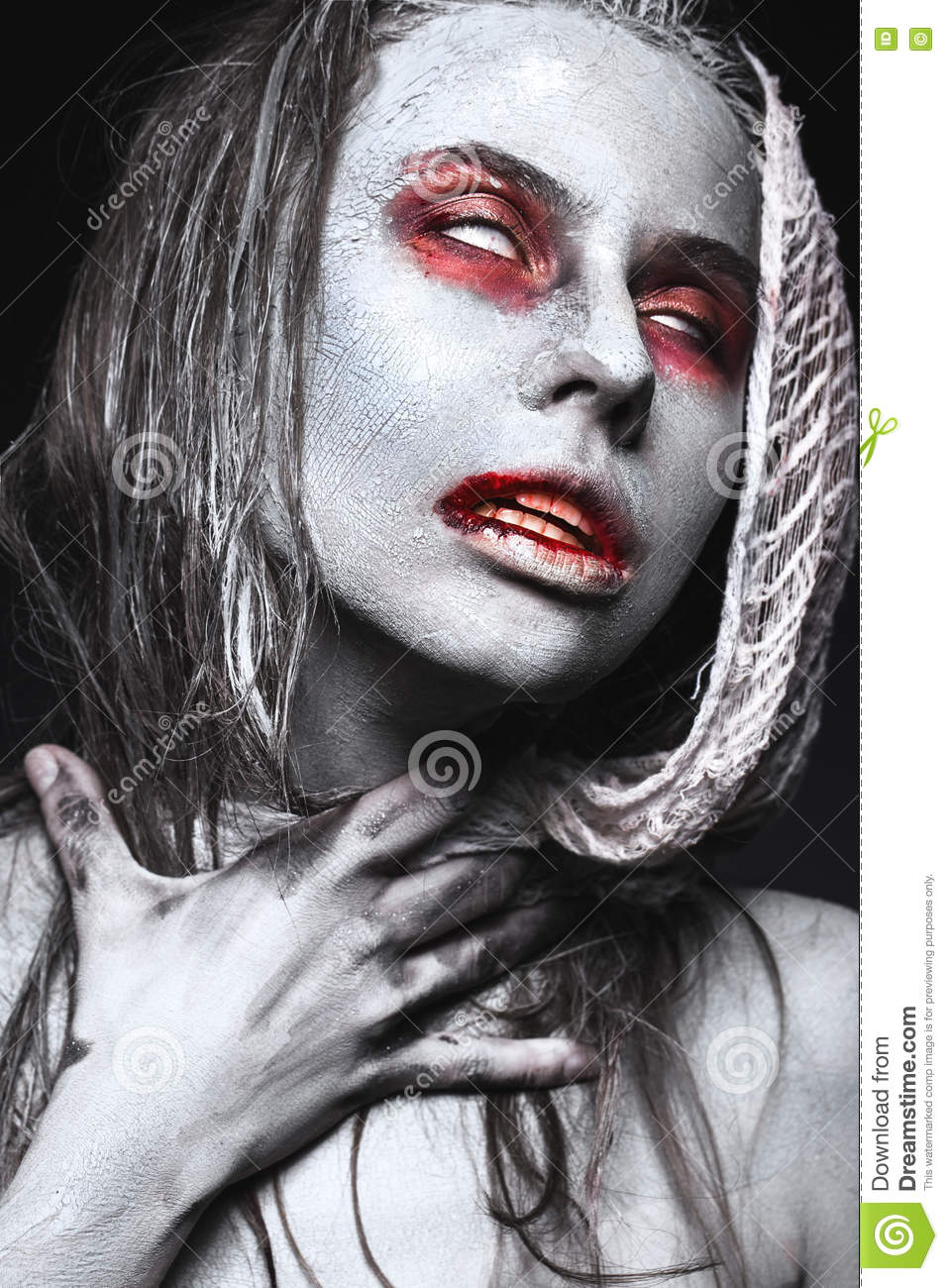 girl in form of zombies, halloween corpse with blood on his lips