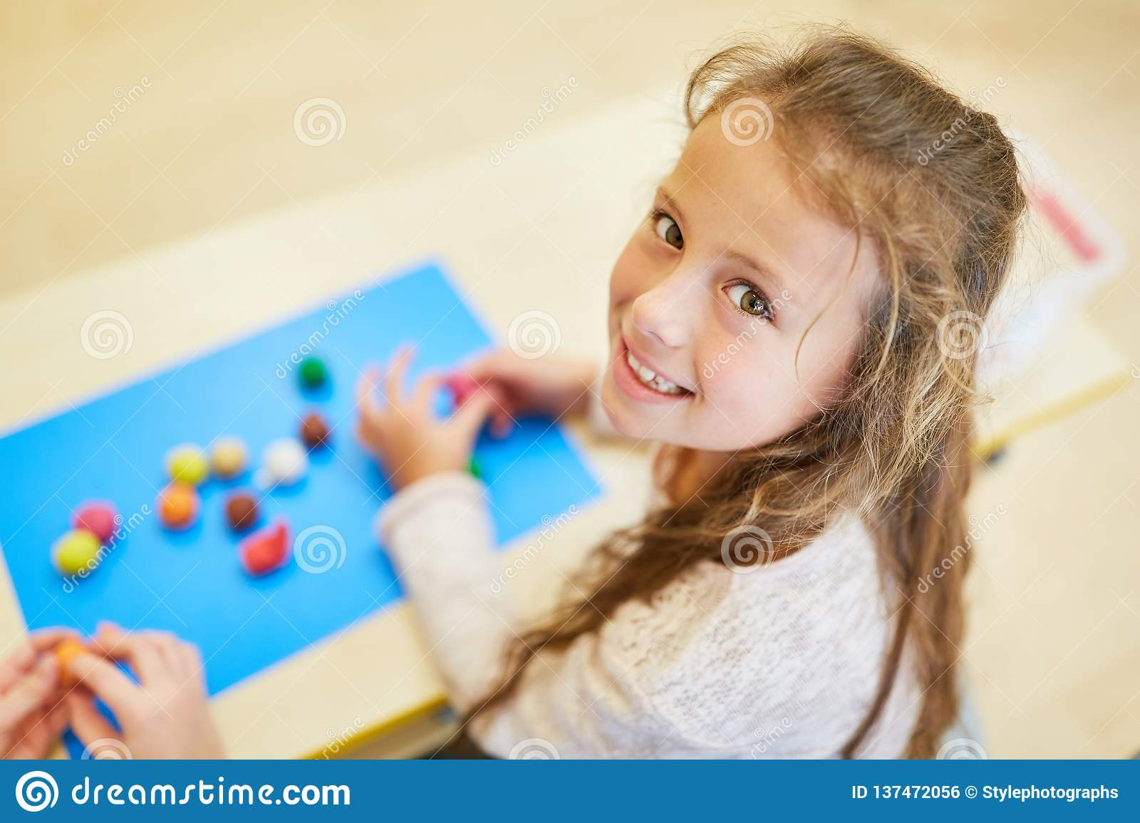 Girl at a game in preschool