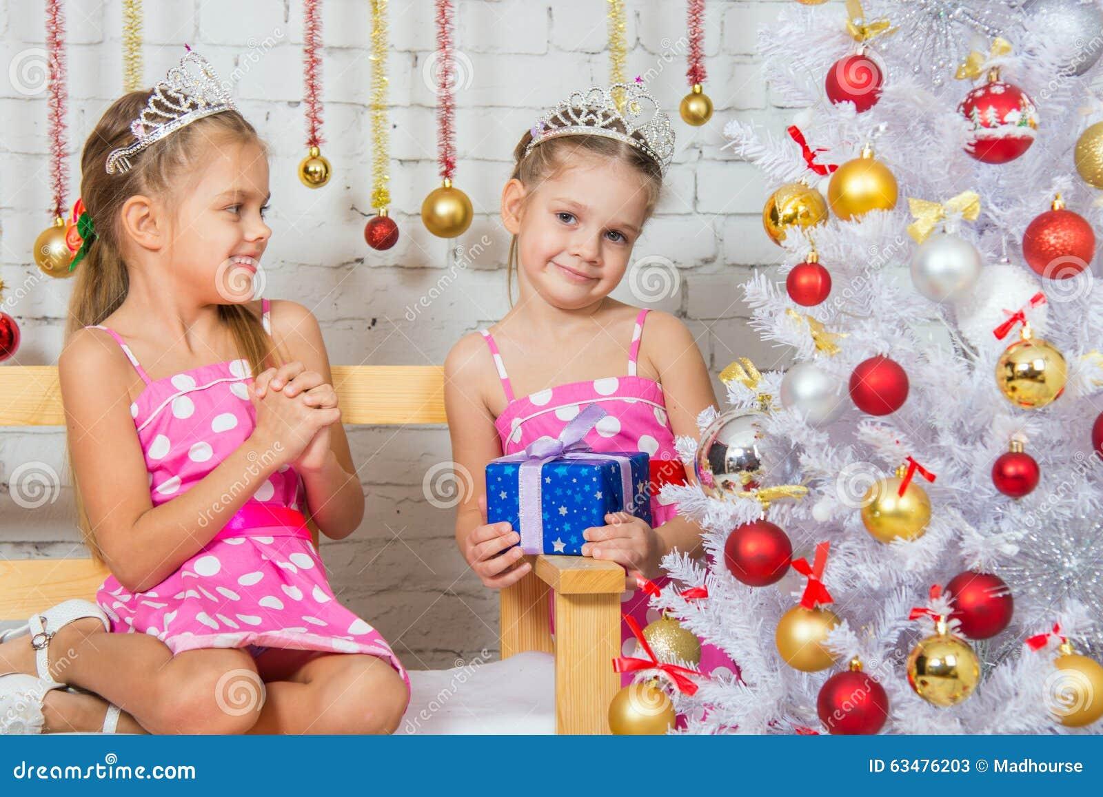 The Girl Gave Her Sister A Christmas Gift Stock Image ...
