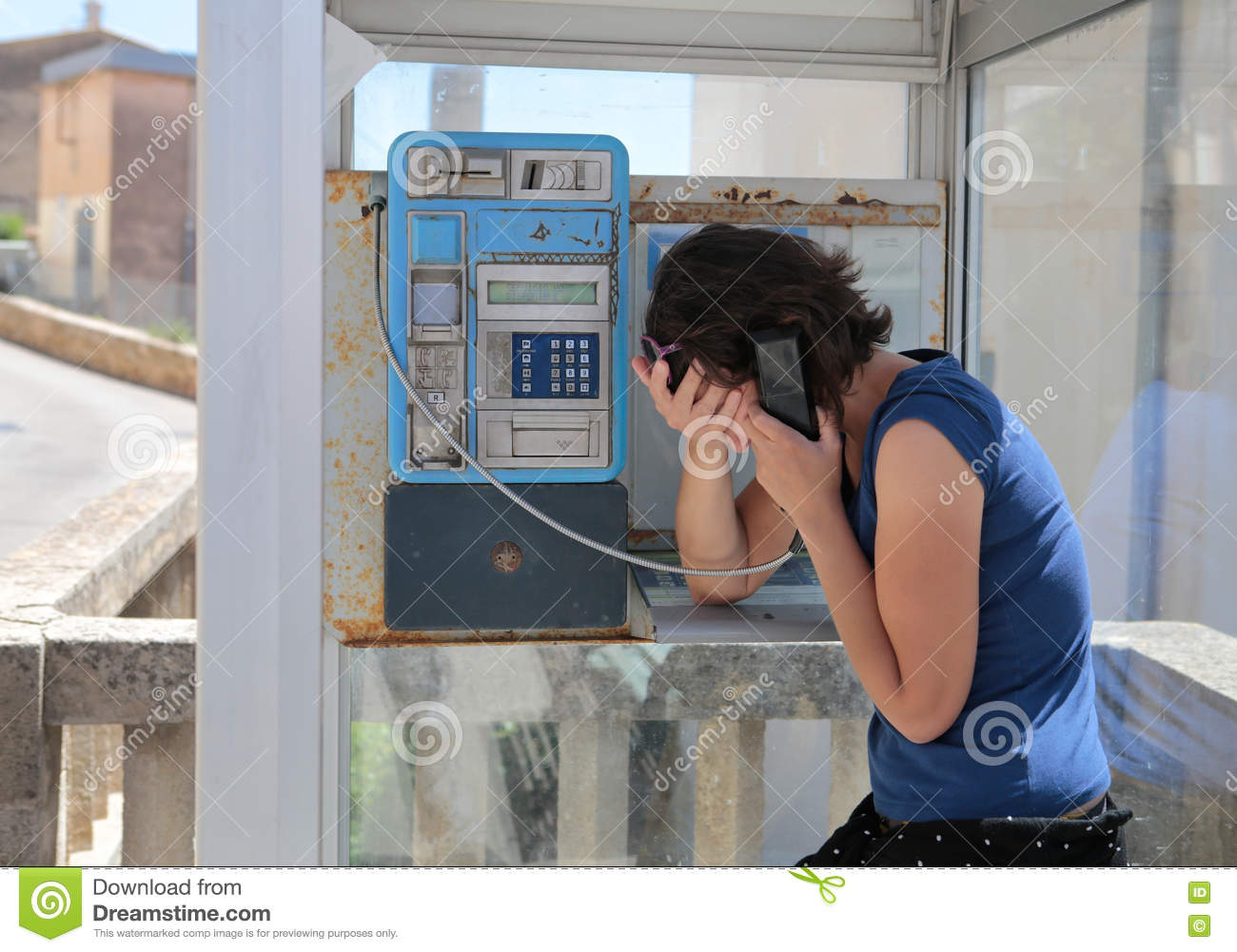 Girl gesturing sad on a phone cabin stock photography for The girl in the cabin
