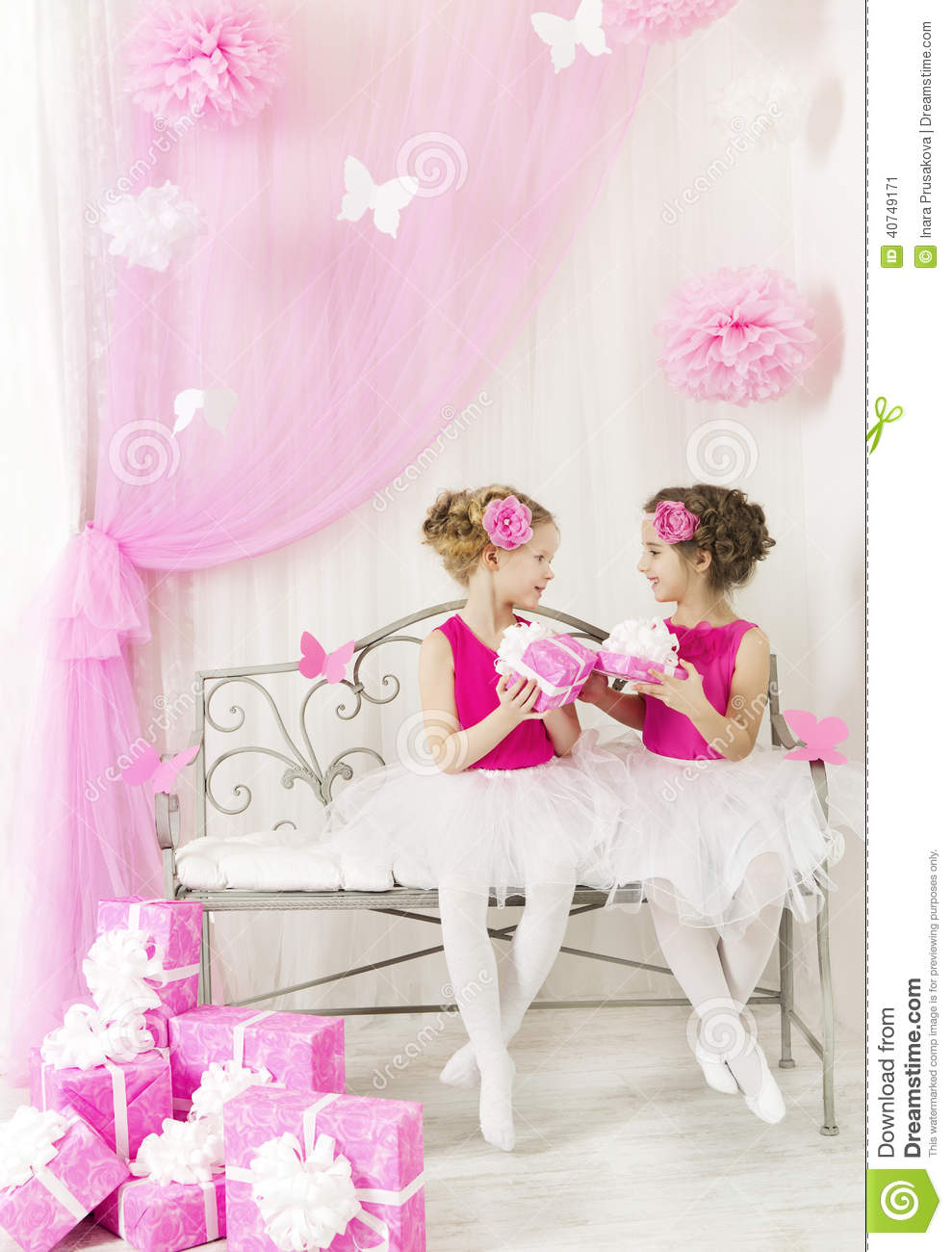 Girl Giving Children Birthday Present To Sister Kids Gift Boxes