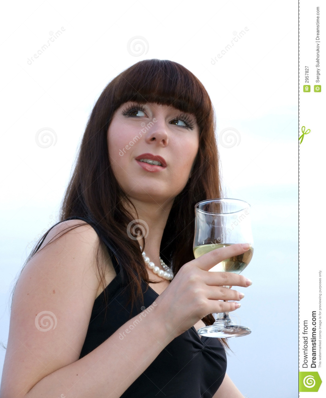 The girl with a glass of wine