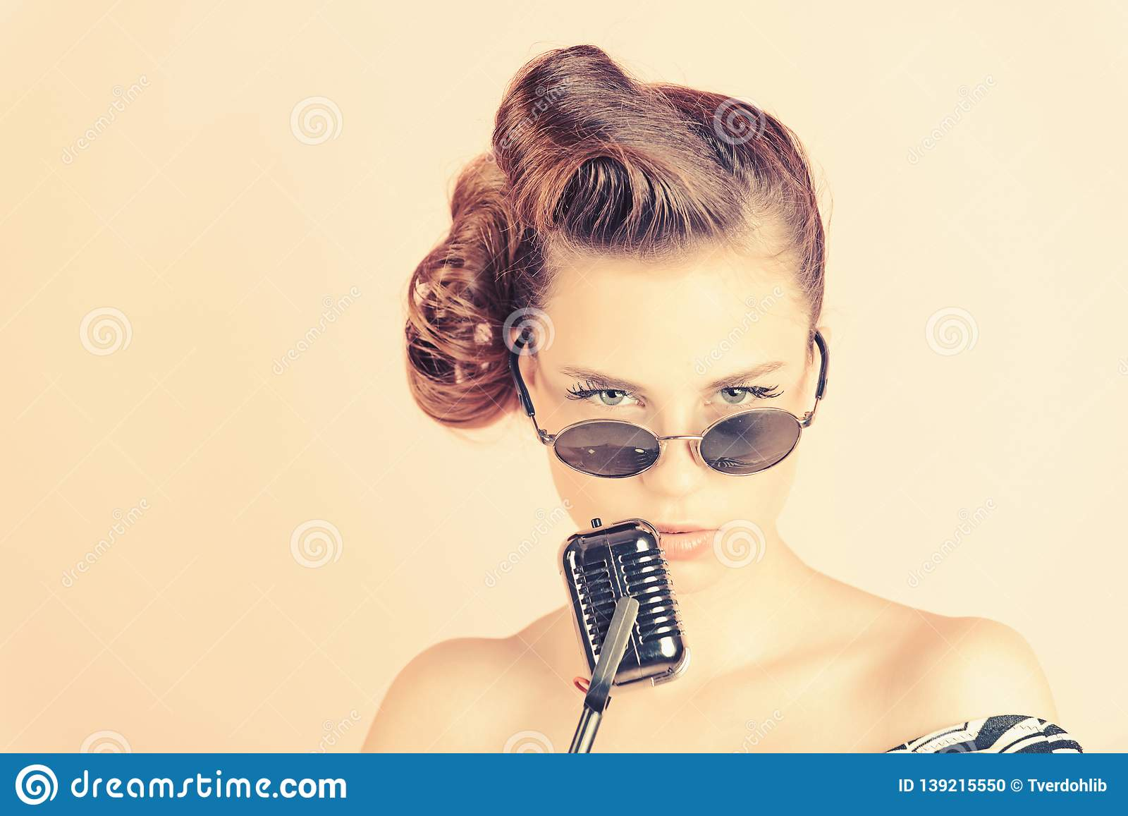 Girl In Glasses Sing In Microphone  Stock Photo - Image of