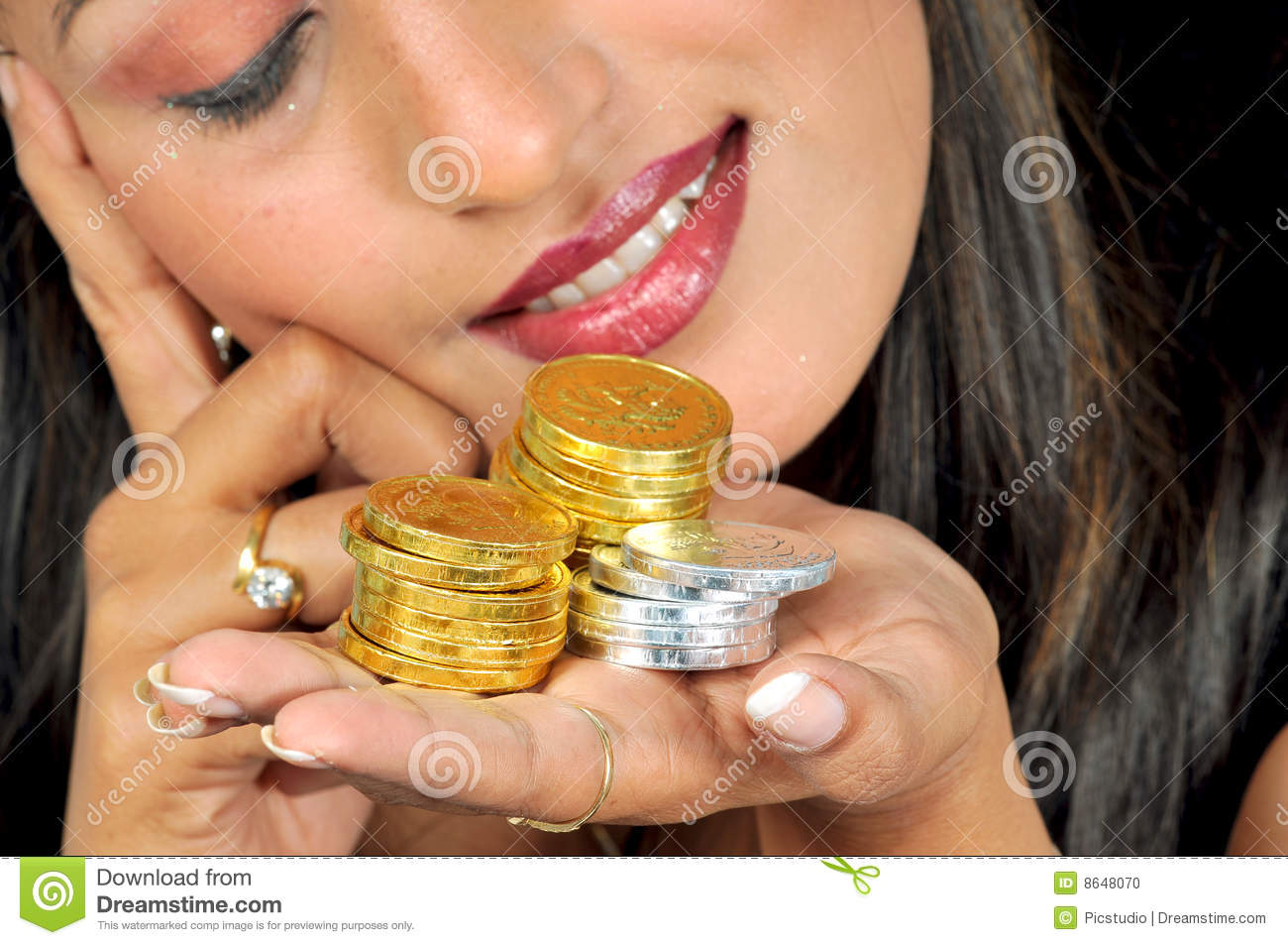 Girl with golden and silver coins