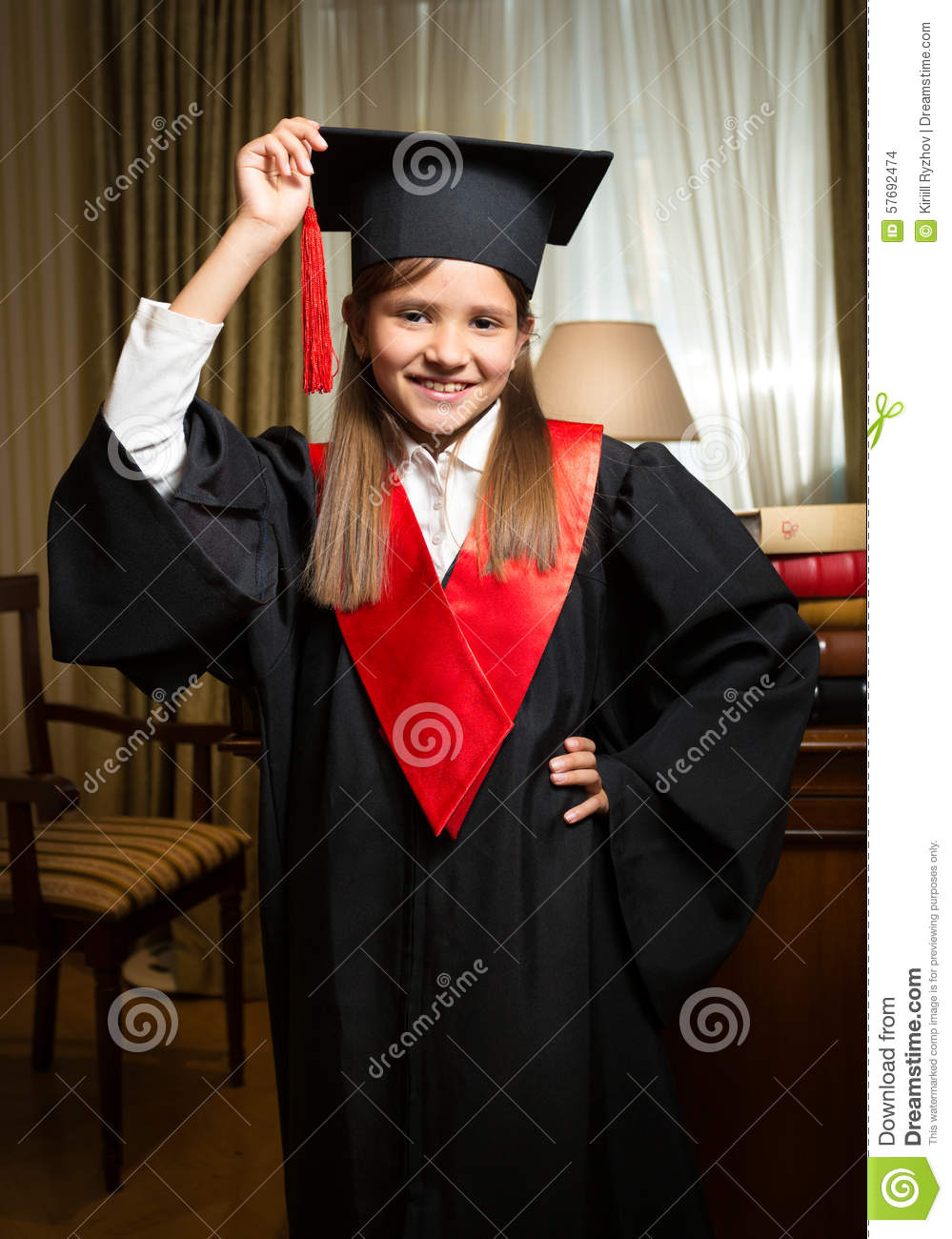 Girl In Graduation Cap And Gown Posing At Classic Interior Stock ...