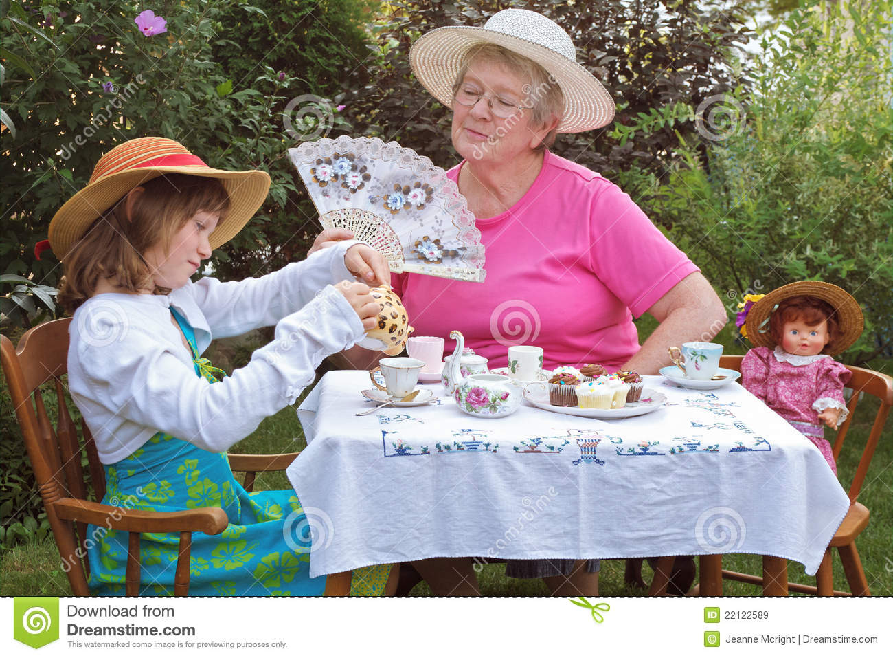 Girl And Grandmother Have A Tea Party Royalty Free Stock