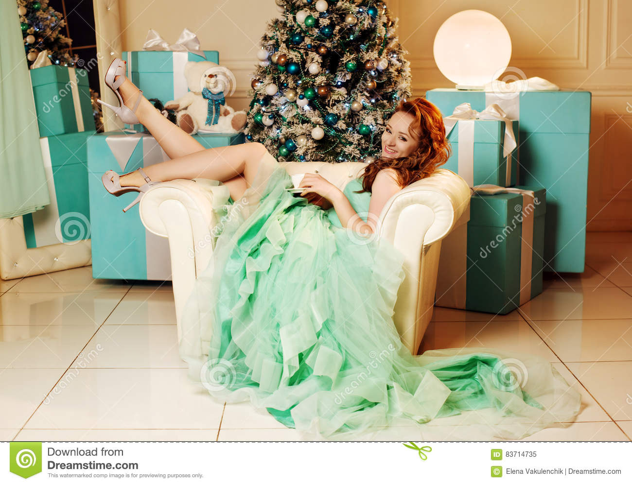 Girl In Green Dress With Christmas Tree Stock Photo