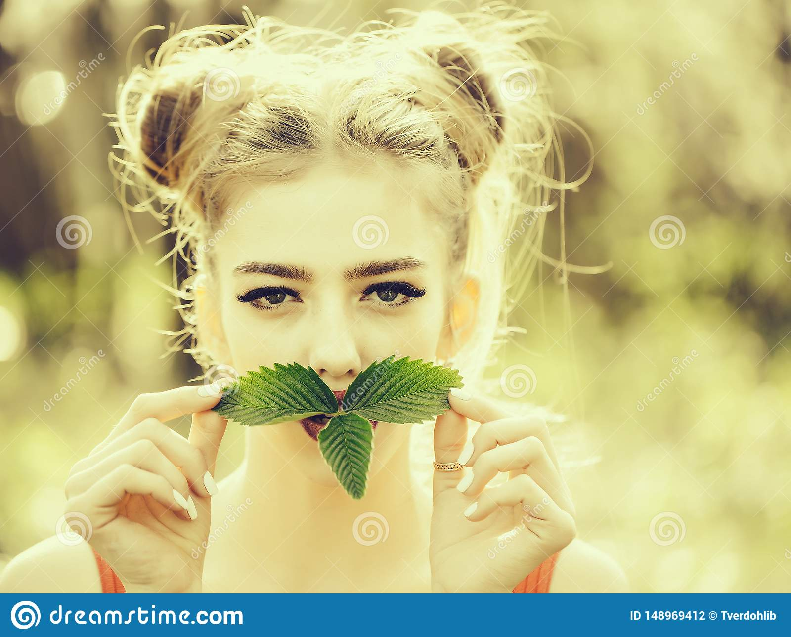 Girl with green leaves