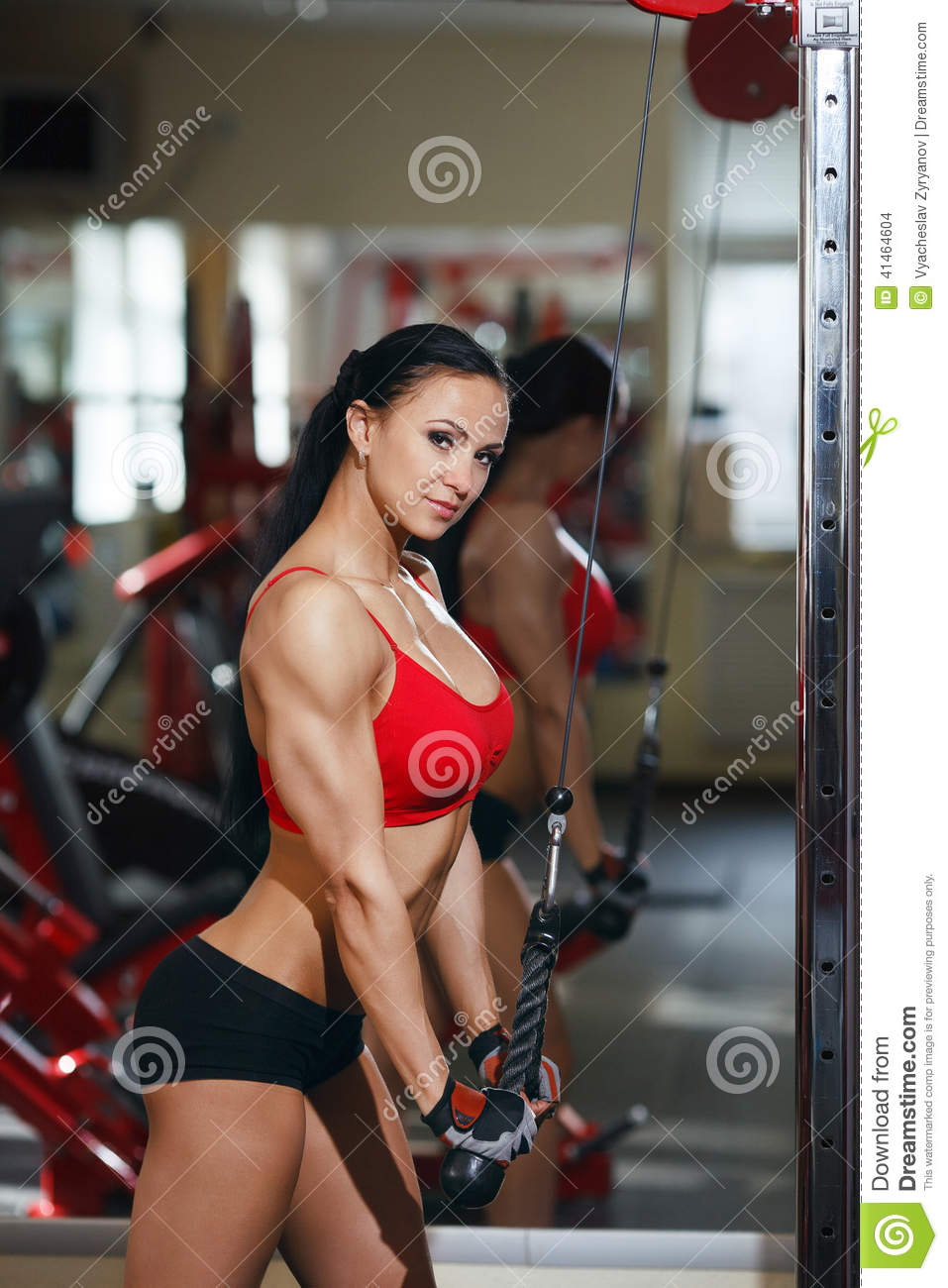 Girl In A Gym Doing Triceps Exercises On Block Exerciser