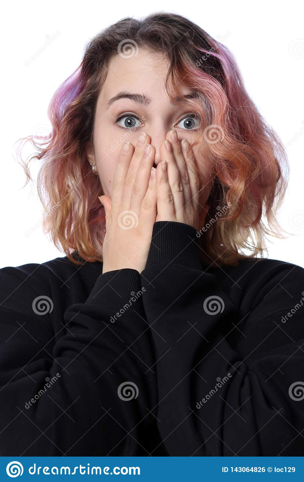 Girl with a haircut on a white background. Bright emotion of surprise. Red hair