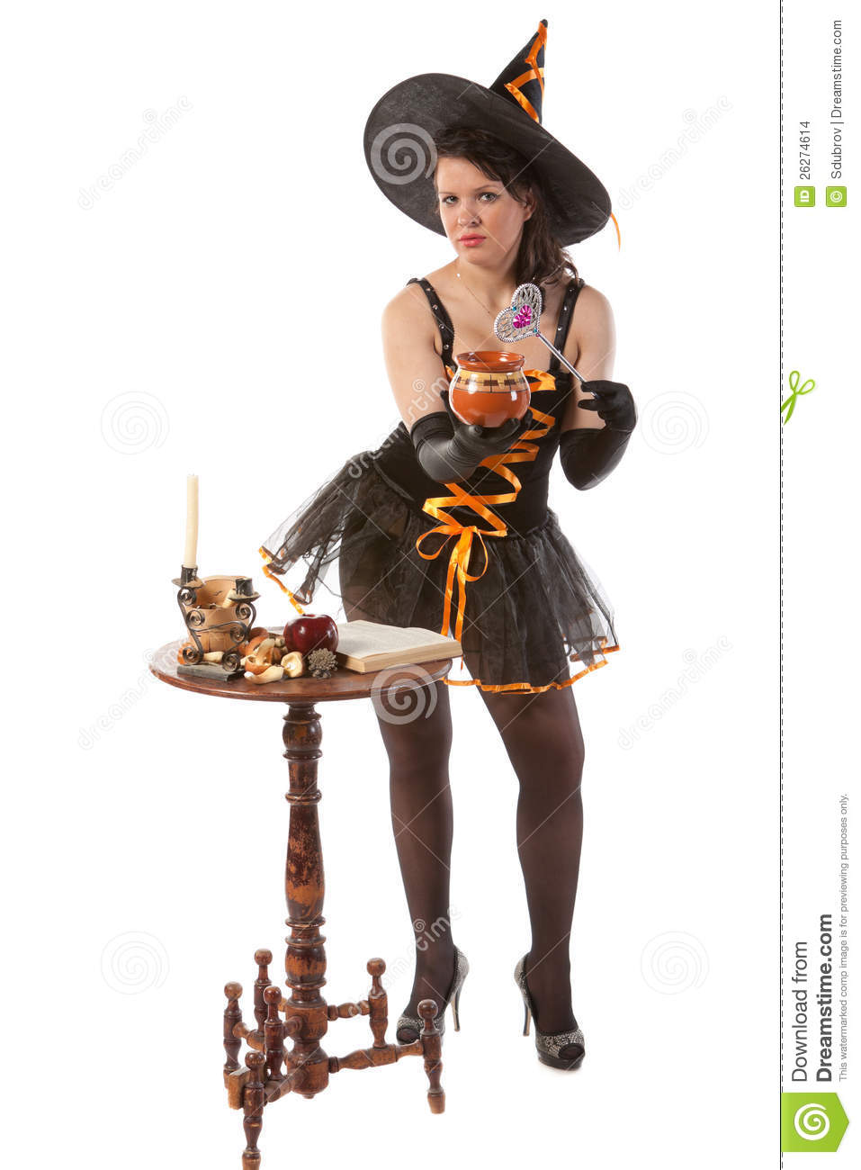 girl in halloween witch costume prepares a potion stock. Black Bedroom Furniture Sets. Home Design Ideas
