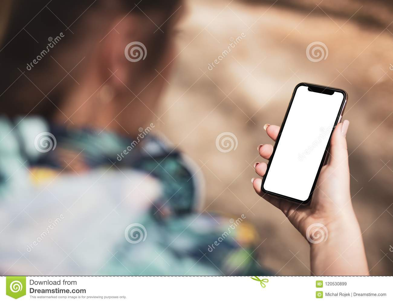 Girl hand holding the black smartphone with big blank screen