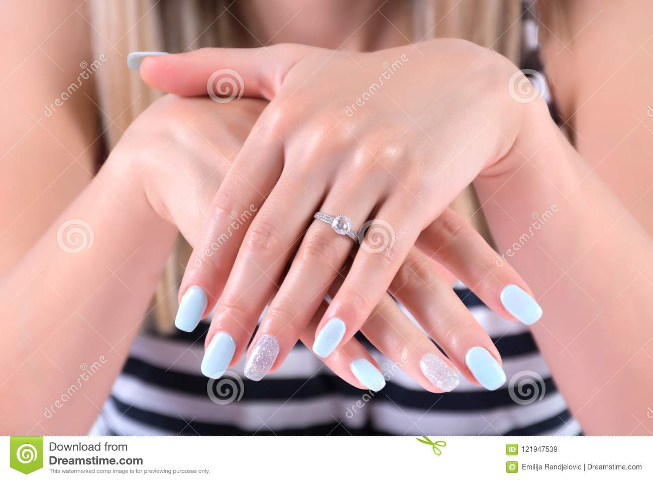 Girl Hands With Blue Nails Polish Manicure And Diamond Engagement ...