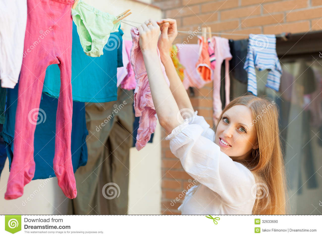 Girl Hanging Clothes On Clothesline Stock Photo Image