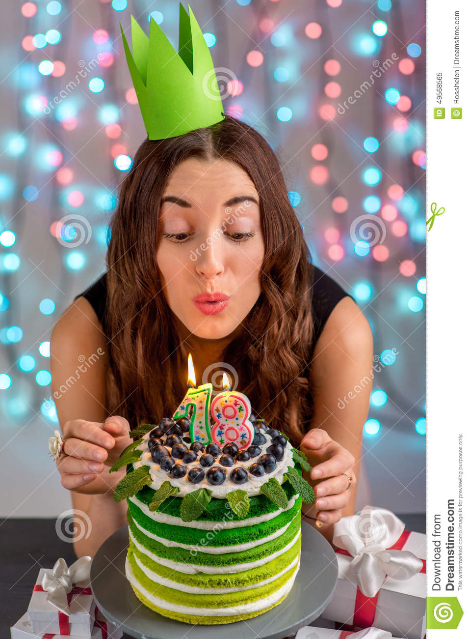Eighteen Girl With Happy Birthday Cake Blowing Up Candles On Festive Light Background