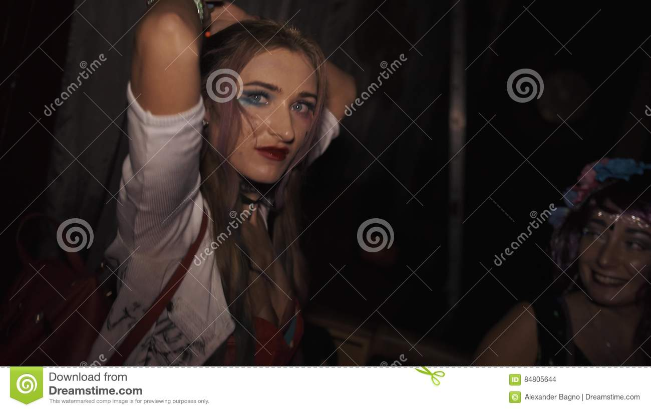 Girl In Harley Quinn Costume Dancing During Halloween Party In ...