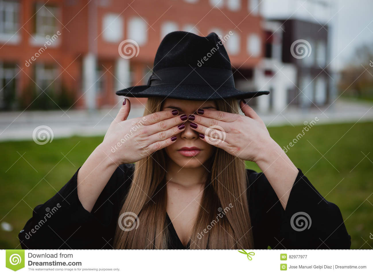 43a90e65b2e Girl With A Hat Covering Her Face With The Hands Stock Image - Image ...