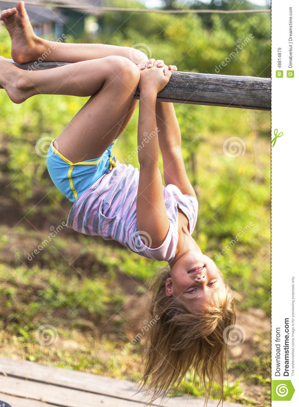 Little Girl Upside Down At Playground Stock Image