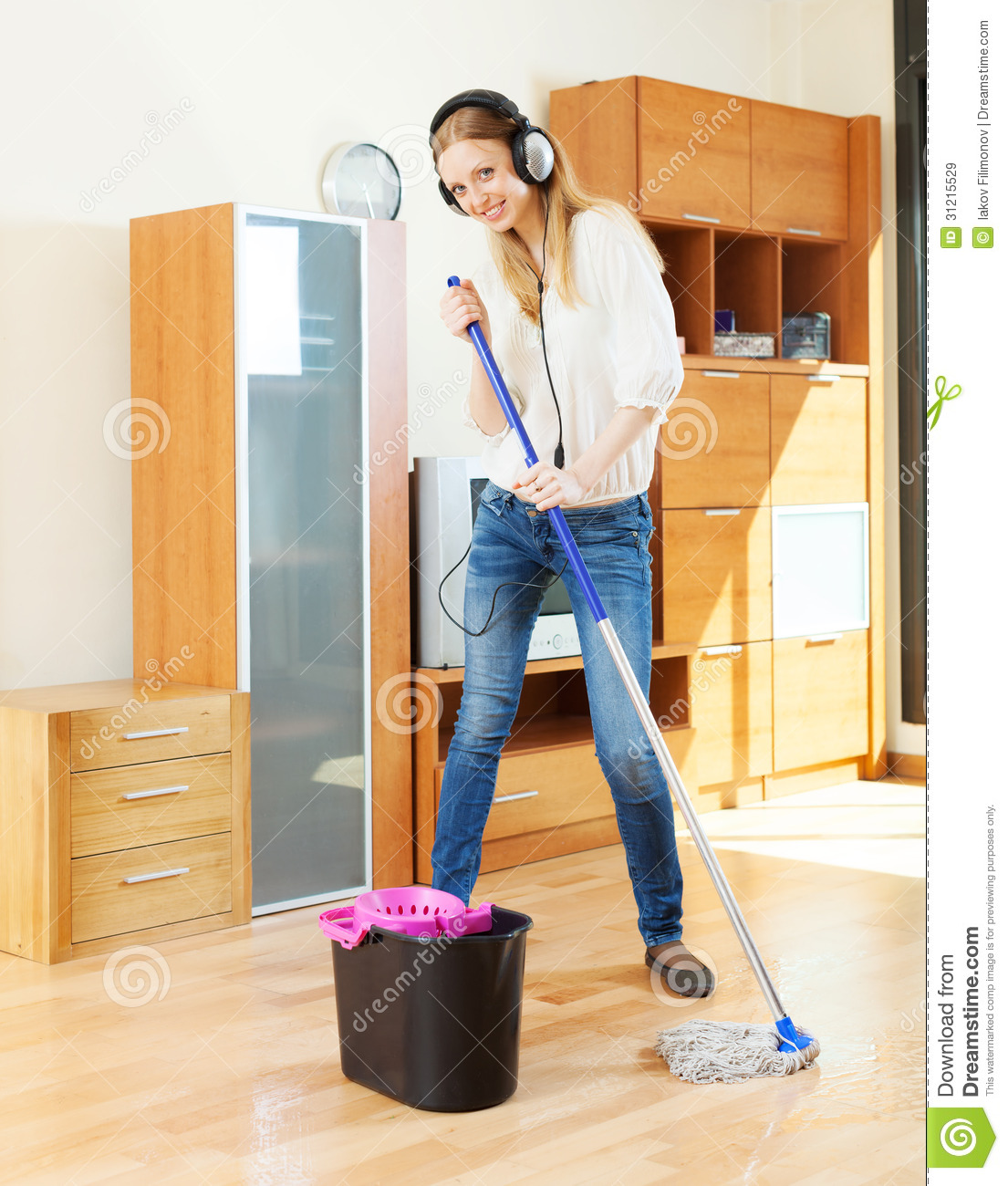 girl in headphones washing floor with mop royalty free girl listening to music clipart person listening to music clipart