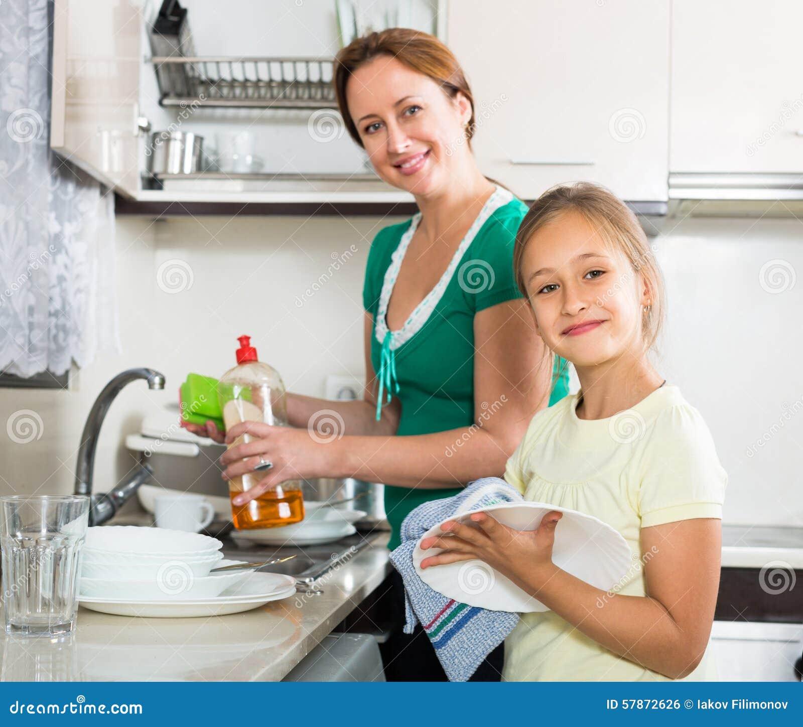 Girl Helping Mother Washing Dishes Stock Photo Image