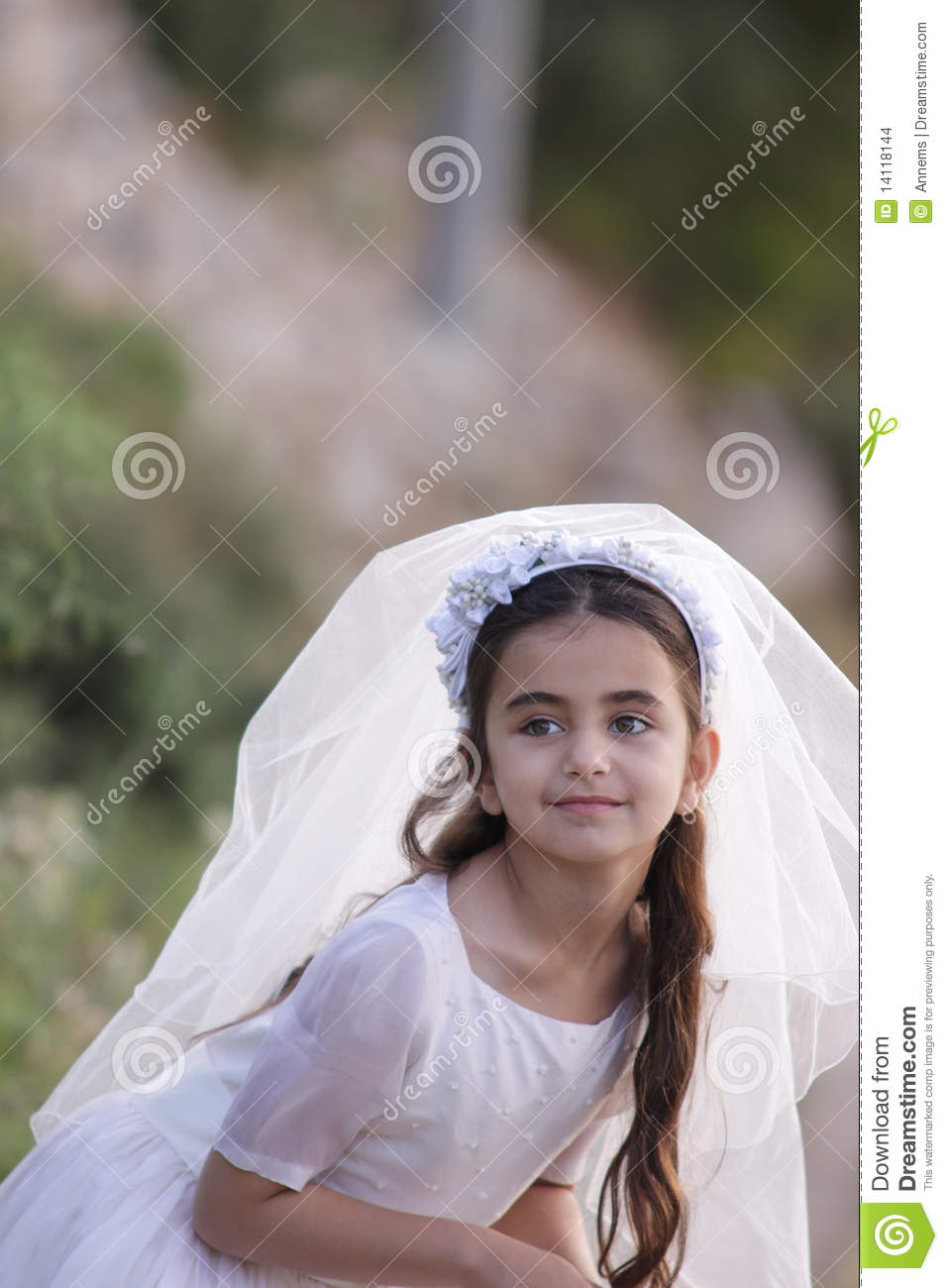 Girl First Birthday Outfit Pinterest: Girl In Her First Communion Dress And Veil Stock Images