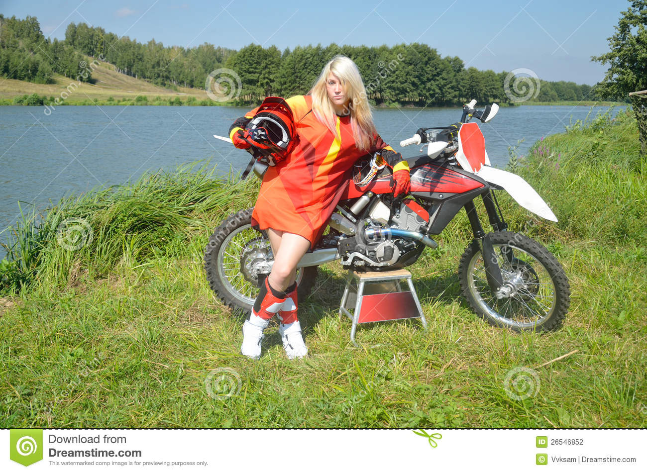 Girl With Her Hair Around A Motocross Bike Stock