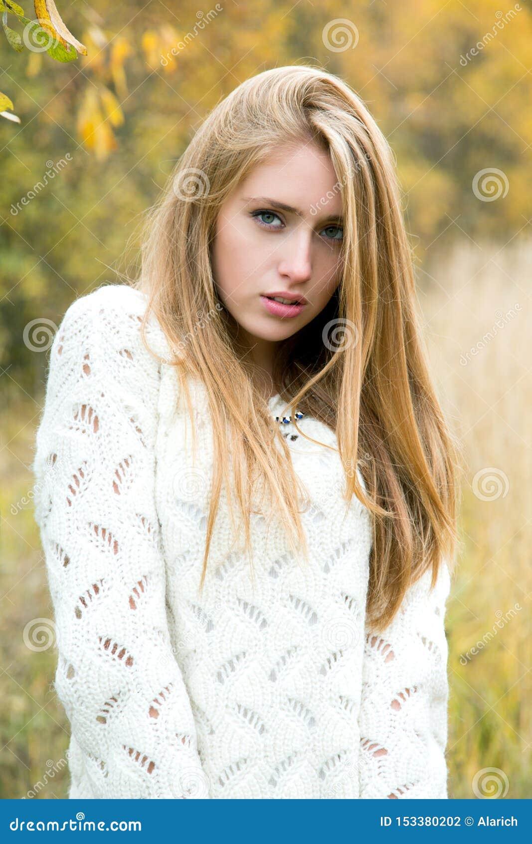 Girl among the high yellow grass