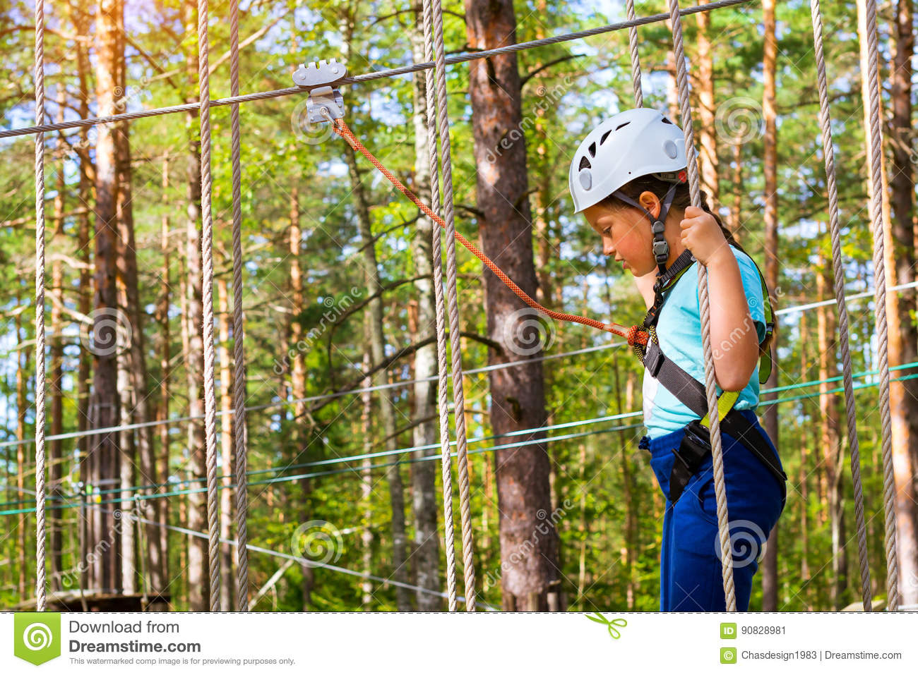 Girl On Hinged Trail In Extreme Rope Park Stock Photo ...