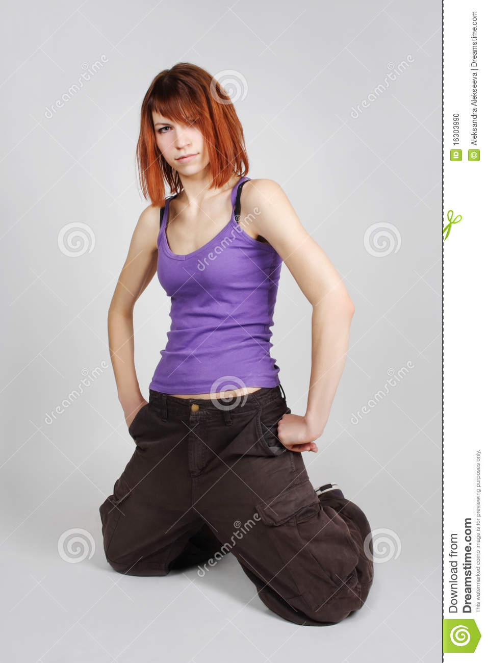 Girl In Hip-Hop Clothes Sitting On Knees Stock Photo -1487