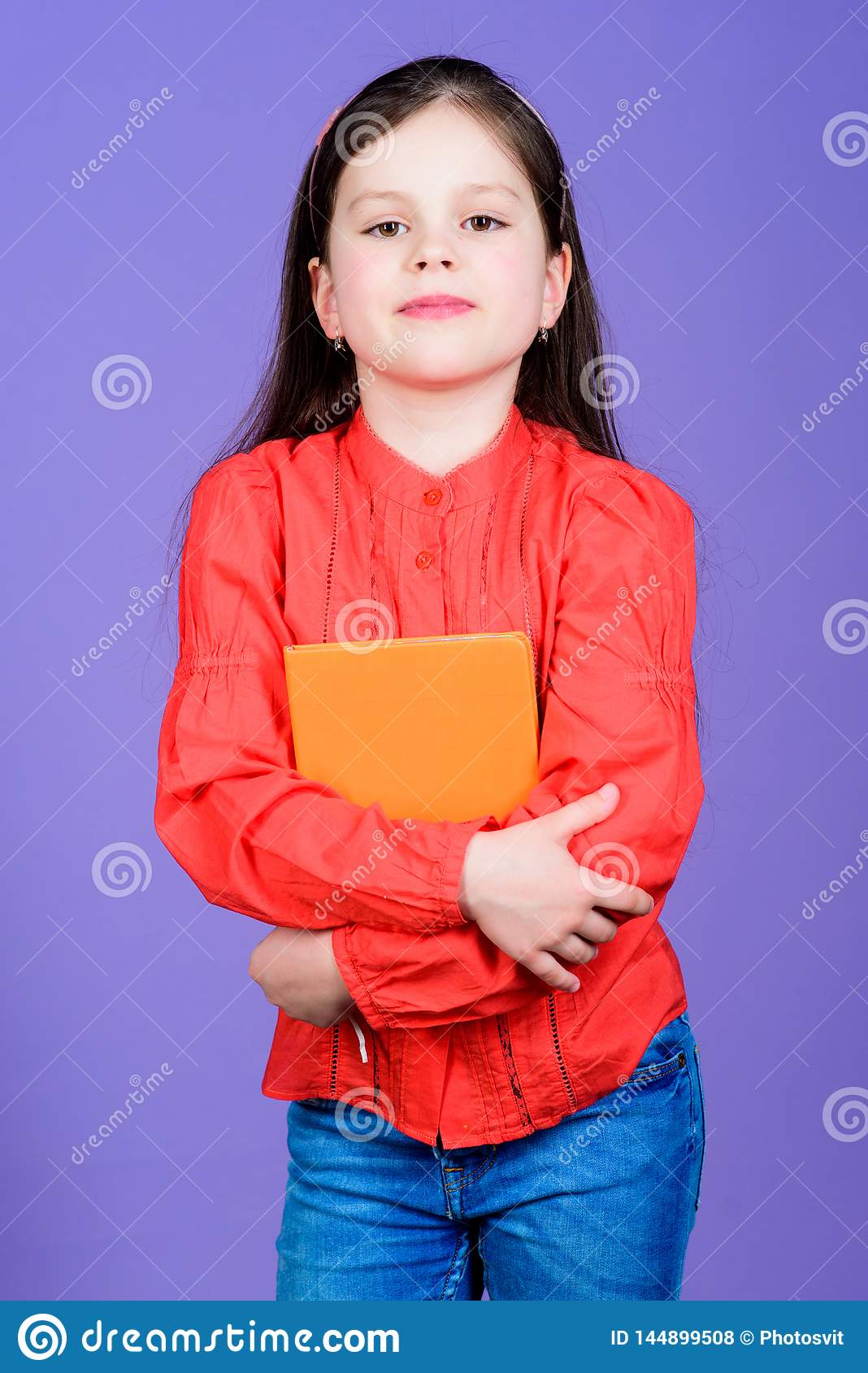 Girl hold book violet background. Kid show book. Book concept. Wise quotes. Literature club. Development and education
