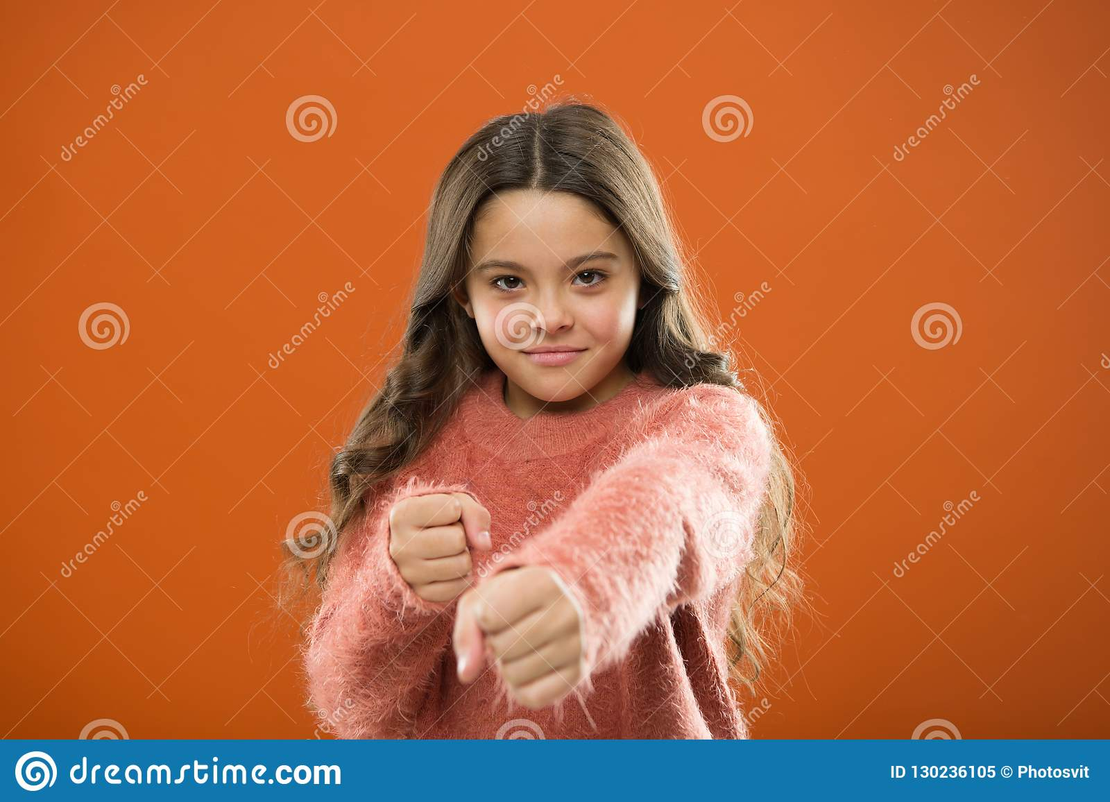 Girl hold fists ready attack or defend. Girl child cute but strong. Self defense for kids. Defend Innocence. How teach
