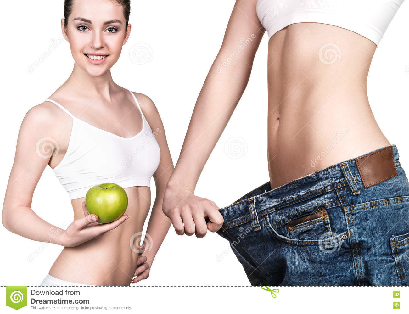 Girl holding an apple and wearing big jeans