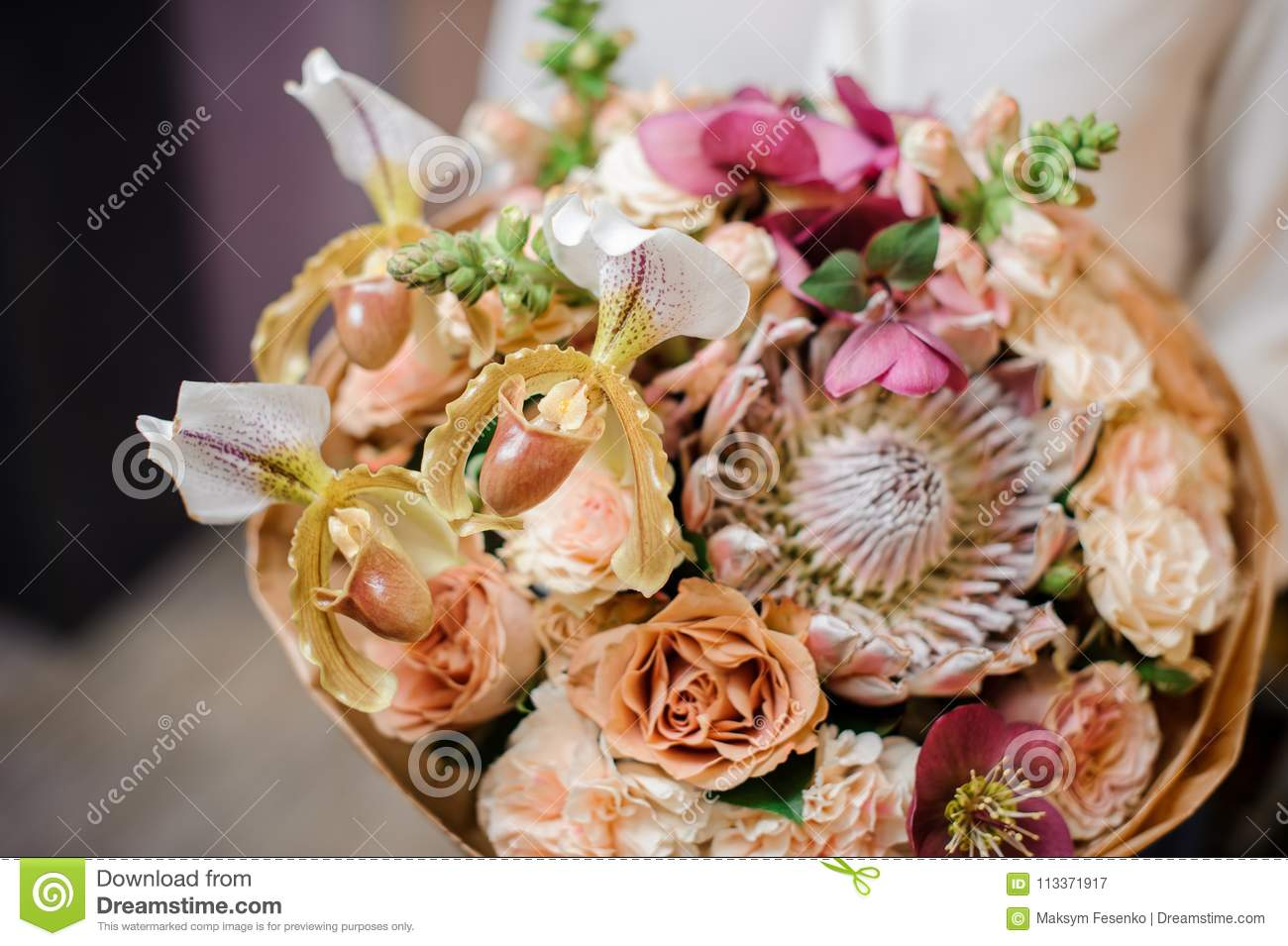 Girl holding a beautiful bouquet of champagne colour flowers stock download girl holding a beautiful bouquet of champagne colour flowers stock image image of brown izmirmasajfo