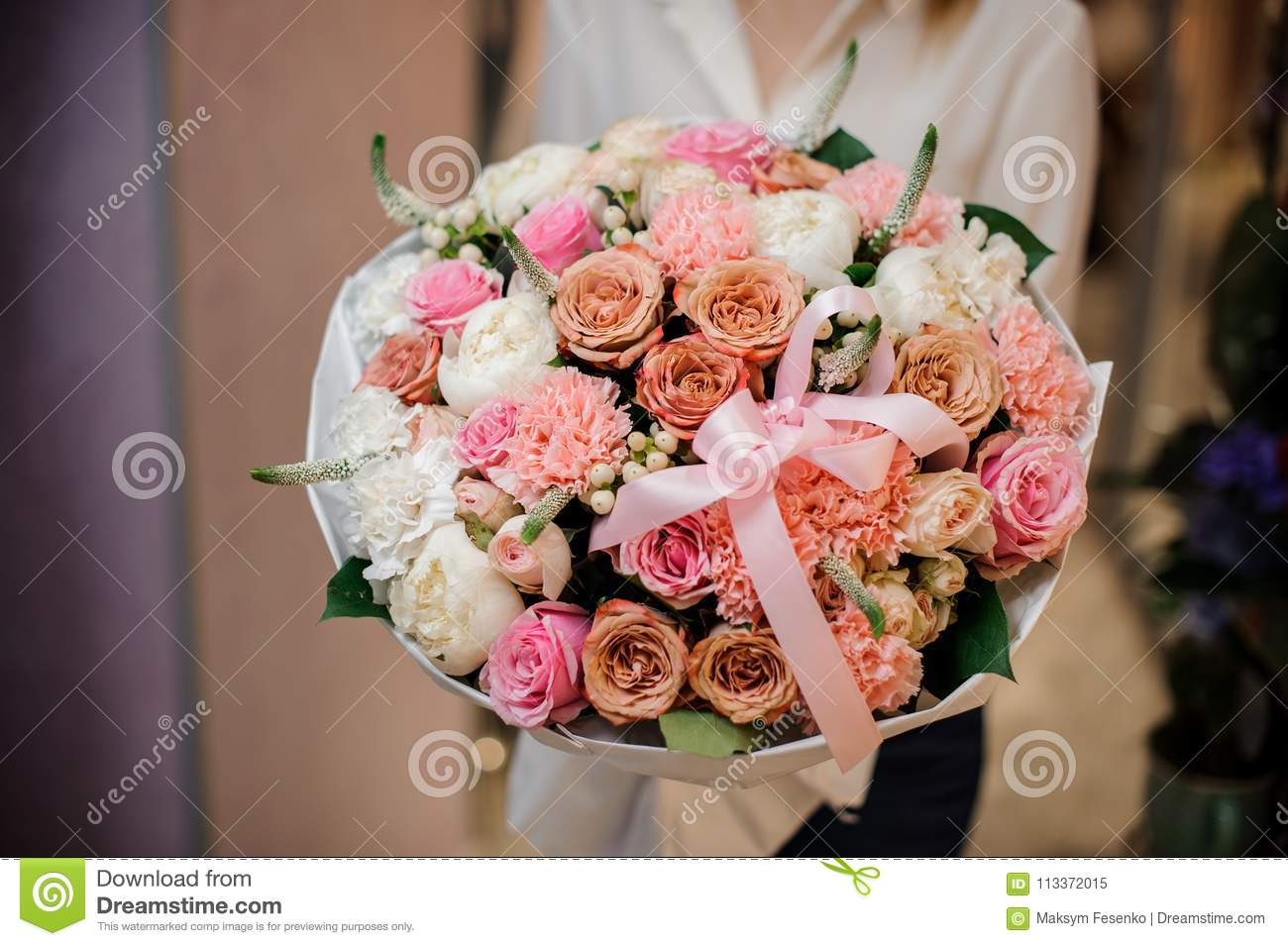 Girl holding a beautiful bouquet of different rosy colour flowers girl holding a beautiful bouquet of different shades of rosy colour flowers decorated with rosy bow izmirmasajfo