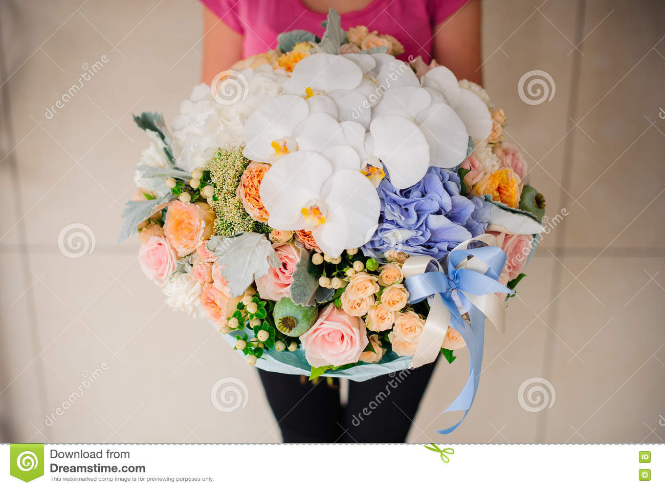 Girl holding beautiful mix flower bouquet with white orchid