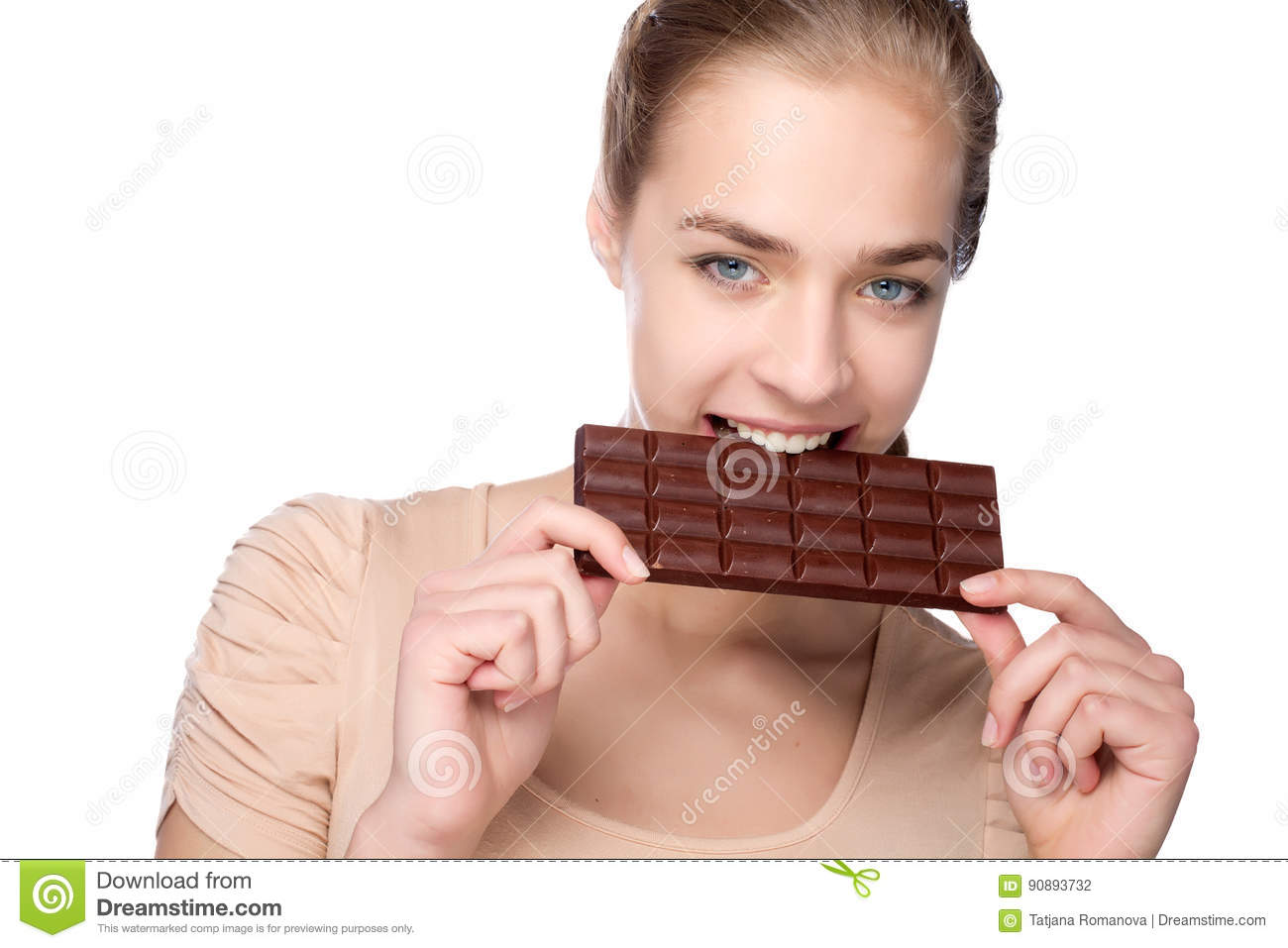Girl holding big chocolate bar in her tooths