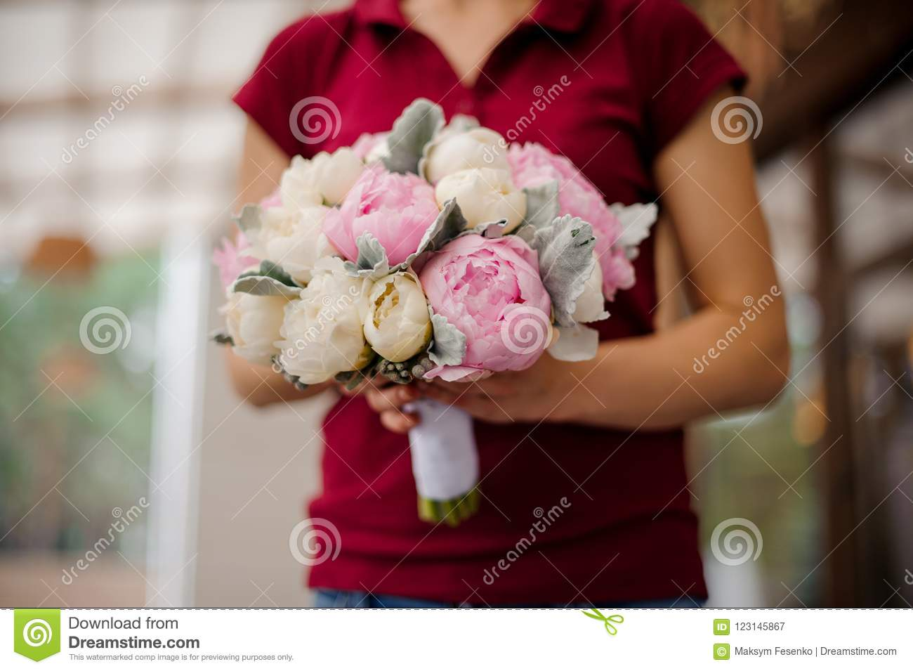 Girl holding bouquet of rose and champagne color peonies