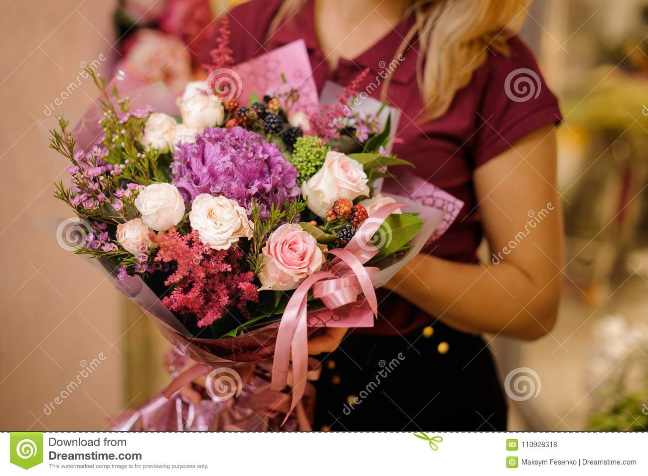 Girl Holding A Bouquet Of Roses, Astilba And Berries Stock Photo ...